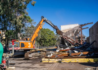 Major Projects Group machine removing plant wall